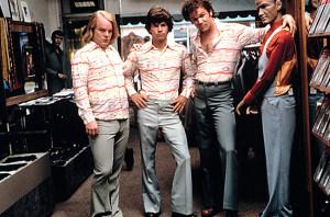 Philip Seymour Hoffman, Mark Wahlberg, and John C. Reilly in Boogie Nights