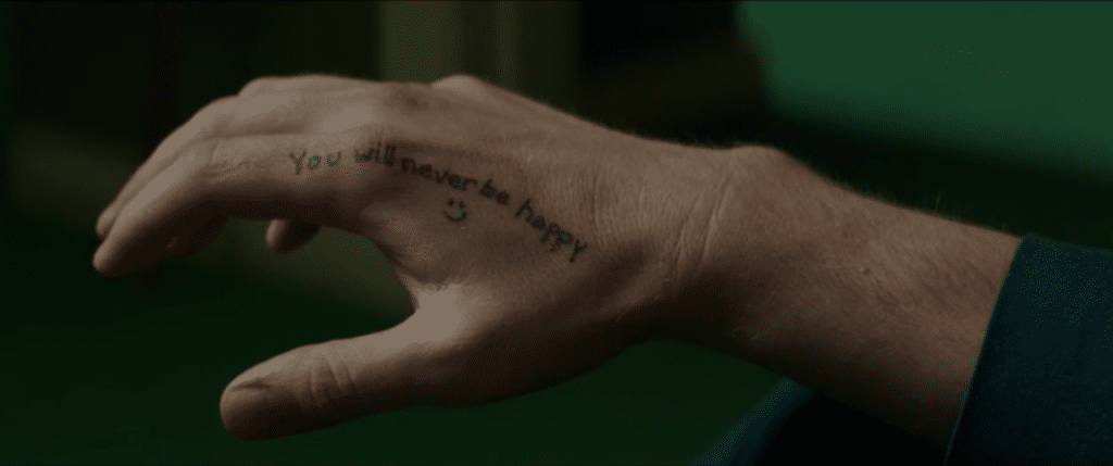 you will never be happy tattoo - Holland March (Ryan Gosling), The Nice Guys