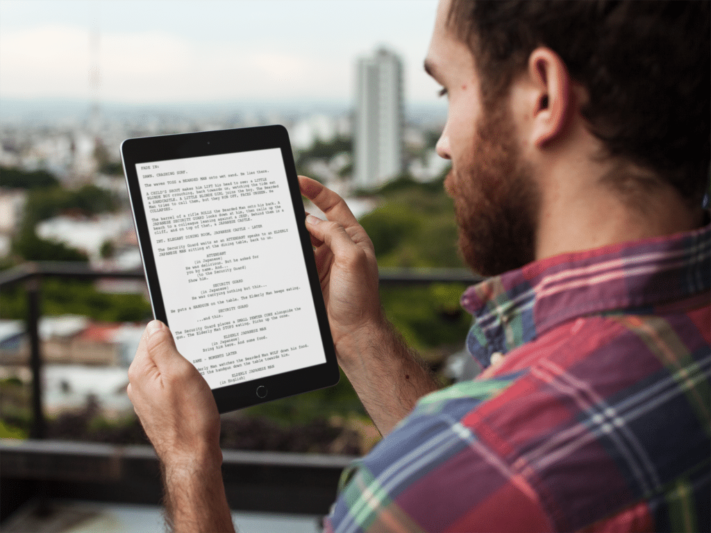 man reading movie script by Industrial Scripts. screenwriting newsletter.