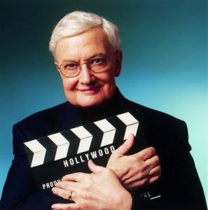 Roger Ebert Holding a Clapperboard
