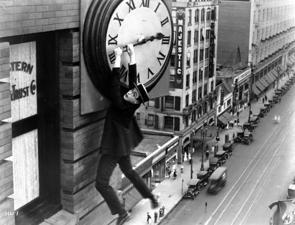 Harold Lloyd hanging from a clock face in Safety Last!